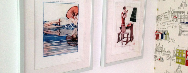 La Vie Parisienne prints on a wall